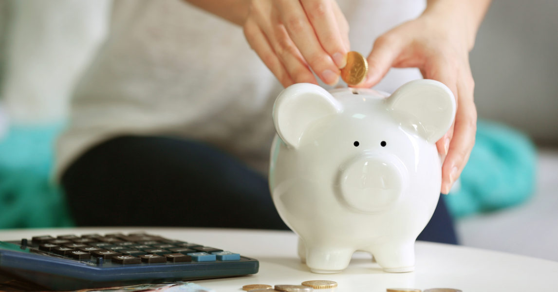 Understanding superannuation | Woman putting money into a piggy bank